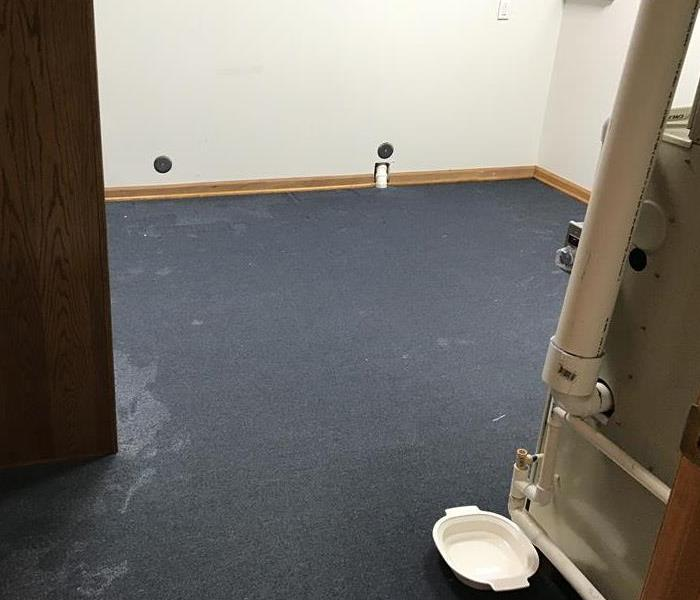 Wet carpet at commercial building